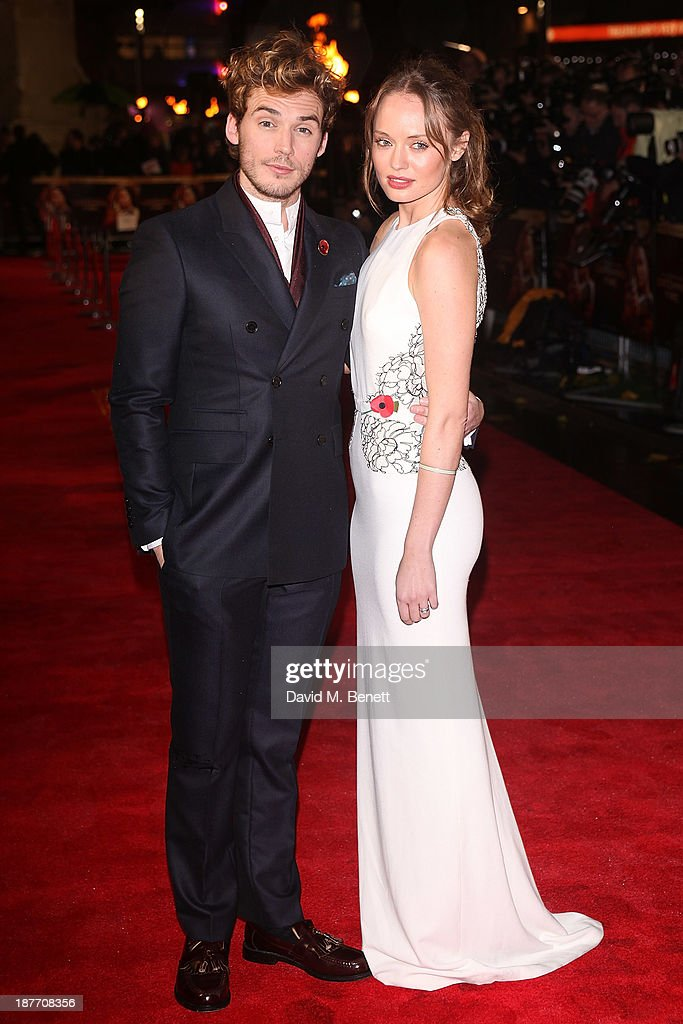 Sam Claflin and Laura Haddock attend the UK Premiere of 'The Hunger Games: Catching Fire' at Odeon Leicester Square on November 11, 2013 in London, England.