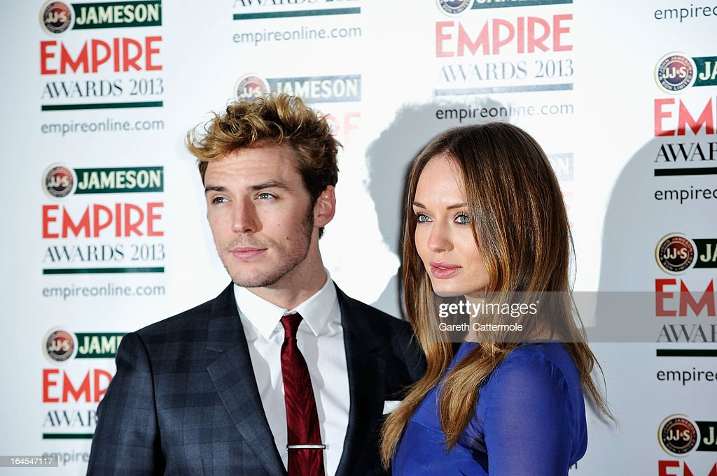 Sam Claflin (L) and Laura Haddock is pictured arriving at the Jameson Empire Awards at Grosvenor House on March 24, 2013 in London, England.