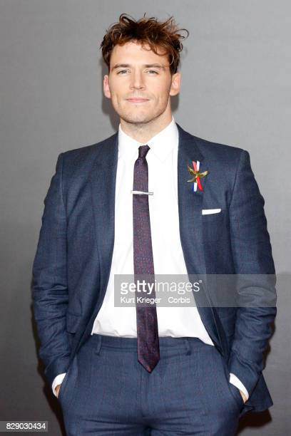 Image has been digitally retouched Sam Claflin arrives at the 'Hunger Games Mockingjay Part 2' premiere in Los Angeles CA on November 16 2015