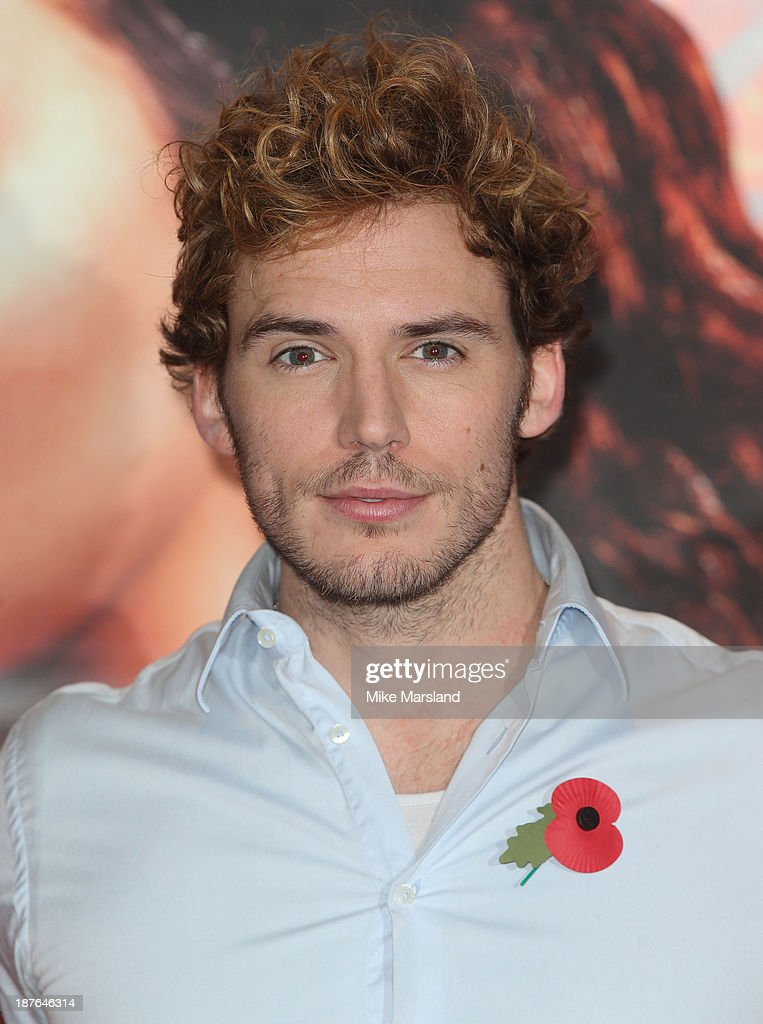 <a gi-track='captionPersonalityLinkClicked' href=/galleries/search?phrase=Sam+Claflin&family=editorial&specificpeople=7238693 ng-click='$event.stopPropagation()'>Sam Claflin</a> attends a photocall for 'The Hunger Games: Catching Fire' on November 11, 2013 in London, England.