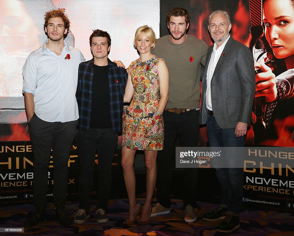 <a gi-track='captionPersonalityLinkClicked' href=/galleries/search?phrase=Sam+Claflin&family=editorial&specificpeople=7238693 ng-click='$event.stopPropagation()'>Sam Claflin</a>, <a gi-track='captionPersonalityLinkClicked' href=/galleries/search?phrase=Josh+Hutcherson&family=editorial&specificpeople=673588 ng-click='$event.stopPropagation()'>Josh Hutcherson</a>, <a gi-track='captionPersonalityLinkClicked' href=/galleries/search?phrase=Elizabeth+Banks&family=editorial&specificpeople=202475 ng-click='$event.stopPropagation()'>Elizabeth Banks</a>, <a gi-track='captionPersonalityLinkClicked' href=/galleries/search?phrase=Liam+Hemsworth&family=editorial&specificpeople=6338547 ng-click='$event.stopPropagation()'>Liam Hemsworth</a> and <a gi-track='captionPersonalityLinkClicked' href=/galleries/search?phrase=Francis+Lawrence&family=editorial&specificpeople=224820 ng-click='$event.stopPropagation()'>Francis Lawrence</a> attend a photocall for 'The Hunger Games: Catching Fire' at Corinthia Hotel London on November 11, 2013 in London, England.