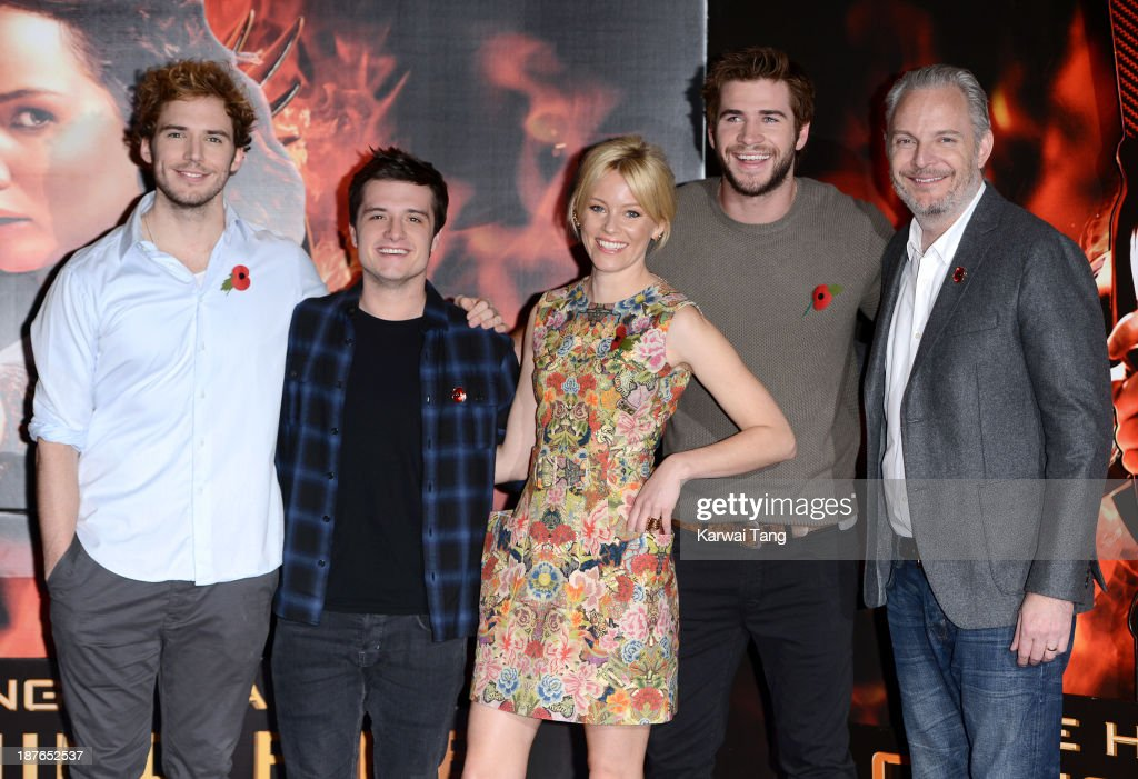 Sam Claflin, Josh Hutcherson, Elizabeth Banks, Liam Hemsworth and Stanley Tucci attend a photocall for 'The Hunger Games: Catching Fire' held at the Corinthia Hotel on November 11, 2013 in London, England.