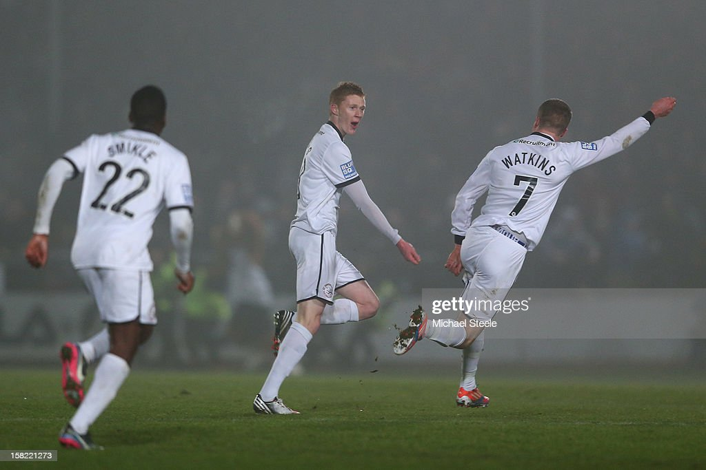 Sam Clucas (C) of Hereford United celebrates scoring the equalising goal with Marley Watkins (R) during the FA Cup with Budweiser Second Round Replay match between Hereford United and Cheltenham Town at Edgar Street Athletic Ground on December 11, 2012 in Hereford, England.