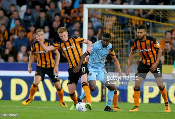 Sam Clucas of Hull City and Bright Enobakhare of Wolves' challenge during the Sky Bet Championship match between Hull City and Wolverhampton...