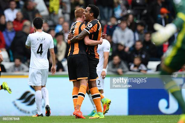 Sam Clucas of Hull City and Tom Huddlestone of Hull City celebrate after Hull City scores the second goal during the Premier League match between...