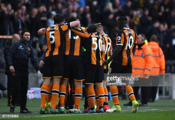 Sam Clucas of Hull City celebrates with team mates after scoring his sides second goal during the Premier League match between Hull City and Watford...
