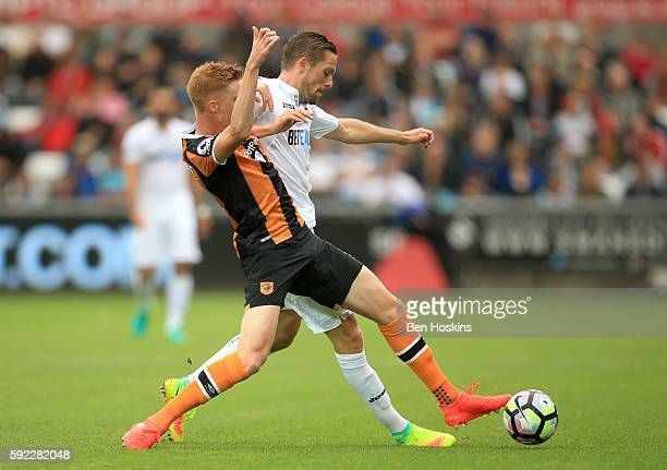 Sam Clucas of Hull City challenges Gylfi Sigurdsson of Swansea City during the Premier League match between Swansea City and Hull City at Liberty...