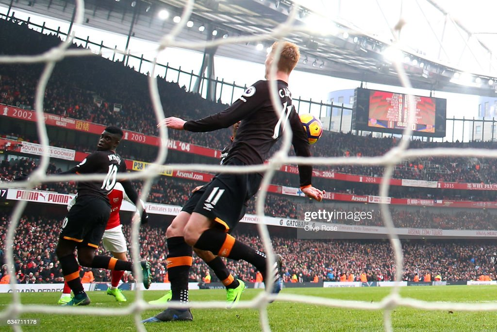 Sam Clucas of Hull City commits a hand ball resulting in a penalty kick to Arsenal during the Premier League match between Arsenal and Hull City at Emirates Stadium on February 11, 2017 in London, England.