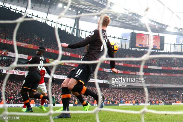 Sam Clucas of Hull City commits a hand ball resulting in a penalty kick to Arsenal during the Premier League match between Arsenal and Hull City at...