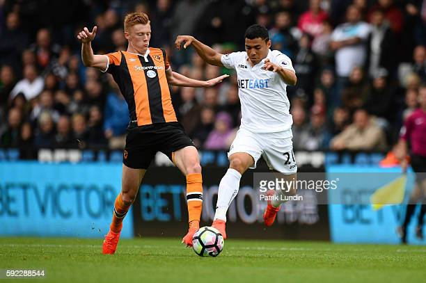 Sam Clucas of Hull City compete for the ball with Jefferson Montero of Swansea City during the Premier League match between Swansea City and Hull...