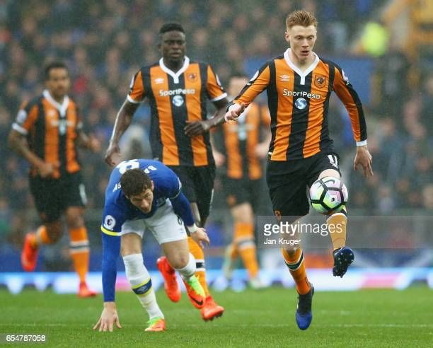 Sam Clucas of Hull City evades Ross Barkley of Everton during the Premier League match between Everton and Hull City at Goodison Park on March 18...