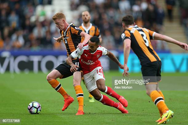 Sam Clucas of Hull City holds off Theo Walcott of ArseTheo Walcott of Arsenal during the Premier League match between Hull City and Arsenal at KCOM...