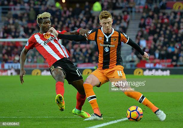 Sam Clucas of Hull City is challenged by Didier Ndong of Sunderland during the Premier League match between Sunderland and Hull City at Stadium of...