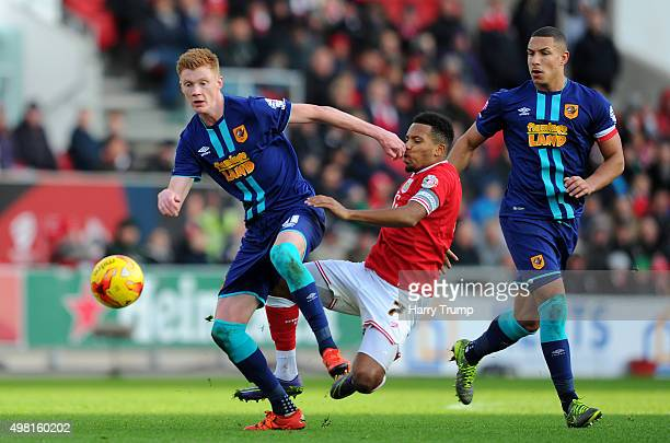 Sam Clucas of Hull City is tackled by Korey Smith of Bristol City during the Sky Bet Championship match between Bristol City and Hull City at Ashton...