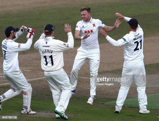 Sam Cook of Essex celebrates with team mates after bowling out Jonathan Trott during the Specsavers County Championship Division One match between...