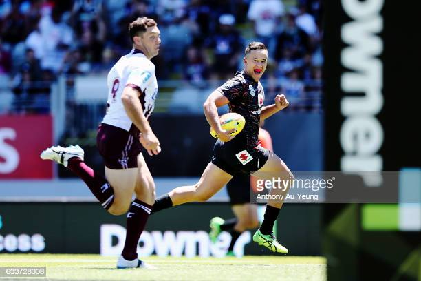 Sam Cook of the Warriors runs in a try in the first half during the 2017 Auckland Nines match between the Warriors and the Sea Eagles at Eden Park on...