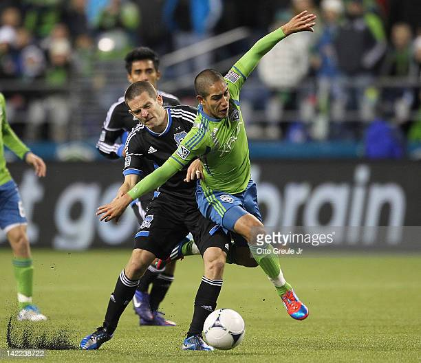 Sam Cronin of the San Jose Earthquakes battles David Estrada of the Seattle Sounders at CenturyLink Field on March 31 2012 in Seattle Washington The...