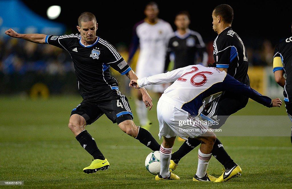 Sam Cronin #4 of the San Jose Earthquakes dribbles the ball away from Sebastian Velasquez #26 of Real Salt Lake during their MLS Soccer game at Buck Shaw Stadium on March 3, 2013 in Santa Clara, California.