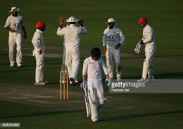 Sam Curran of England Lions leaves the filed after being dismissed by Rashid Khan of Afghanistan during day one of the tour match between England...