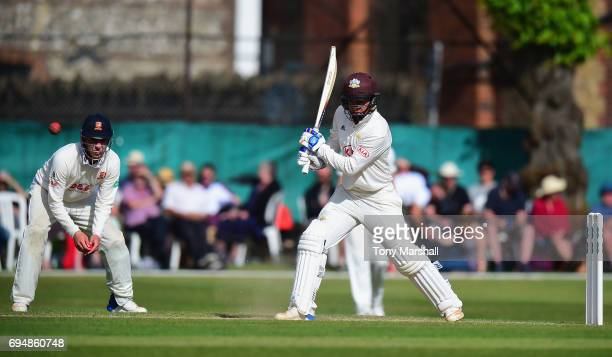 Sam Curran of Surrey bats during the Specsavers County Championship Division One match between Surrey and Essex at Guildford Cricket Club on June 11...