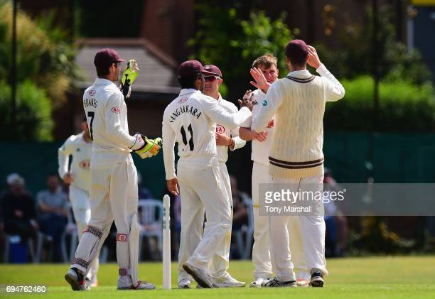 Sam Curran of Surrey celebrates taking the wicket of Neil Wagner of Essex during the Specsavers County Championship Division One match between Surrey...