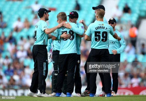 Sam Curran of Surrey celebrates with his teammates after bowling out Luke Wright of Sussex during the NatWest T20 Blast match between Surrey and...