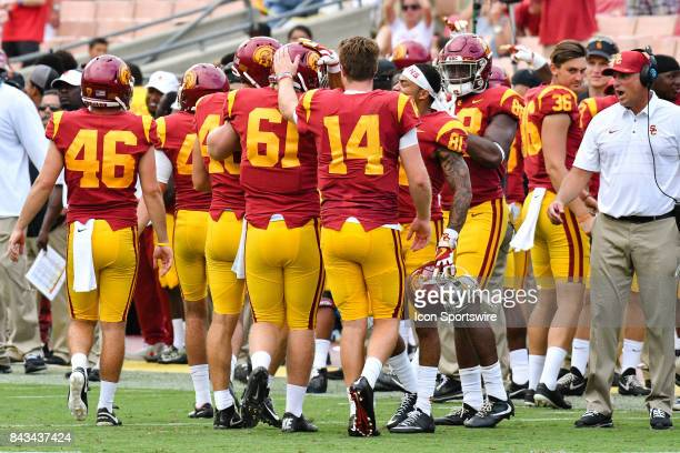 Sam Darnold and teammates greet USC Jake Olson after making his first appearance in a college football game between the Western Michigan Broncos and...