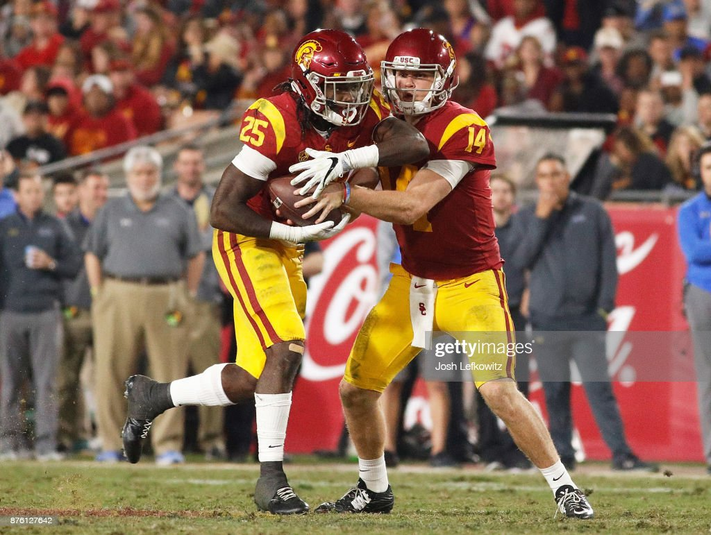 Sam Darnold #14 of the USC Trojans hands the ball off to Ronald Jones II #25 of the USC Trojans during the NCAA college football game at the Los Angeles Memorial Coliseum on November 18, 2017 in Los Angeles, California.