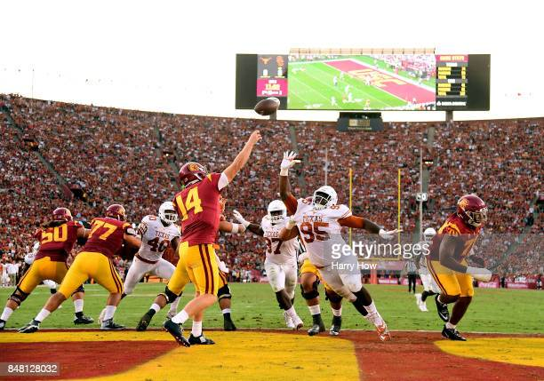 Sam Darnold of the USC Trojans passes over Poona Ford of the Texas Longhorns during the second quarter at Los Angeles Memorial Coliseum on September...