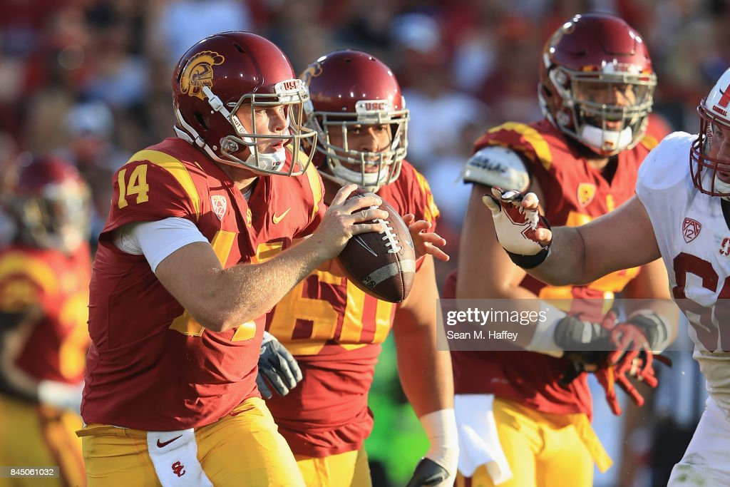 Sam Darnold #14 of the USC Trojans scrambles with the football during the first half against the Stanford Cardinal at Los Angeles Memorial Coliseum on September 9, 2017 in Los Angeles, California.