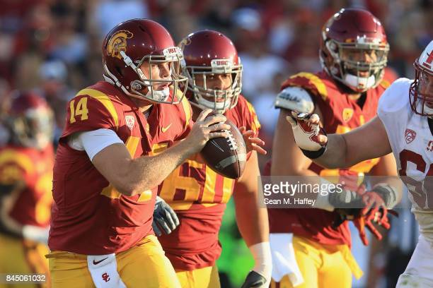 Sam Darnold of the USC Trojans scrambles with the football during the first half against the Stanford Cardinal at Los Angeles Memorial Coliseum on...