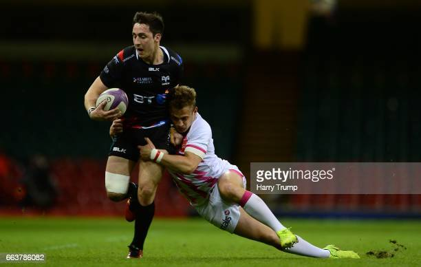 Sam Davies of Ospreys is tackled by Jules Plisson of Stade Francais during the European Rugby Challenge Cup match between Ospreys and Stade Francais...