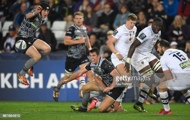 Sam Davies reacts as Ospreys centre Owen Watkin makes a pass to set up the third Ospreys try during the European Rugby Champions Cup match between...