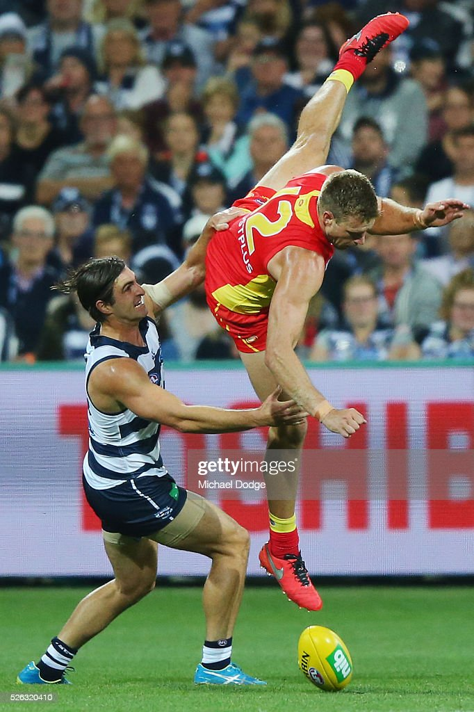 Sam Day of the Suns crashes to the ground after a contest with Shane Kersten of the Cats during the round six AFL match between the Geelong Cats and the Gold Coast Suns at Simonds Stadium on April 30, 2016 in Geelong, Australia.