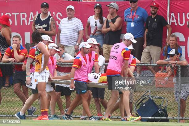 Sam Day of the Suns is stretchered from the field during the 2017 JLT Community Series match at Broadbeach Sports Centre on February 19 2017 in Gold...