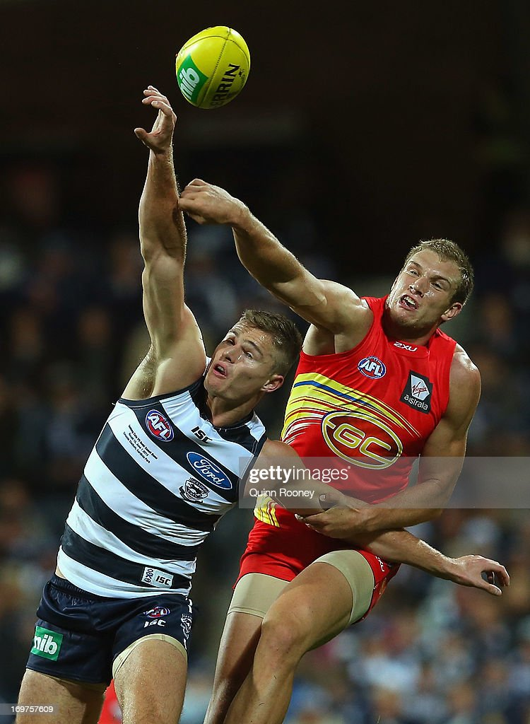 Sam Day of the Suns spoils a mark by Nathan Vardy of the Cats during the round ten AFL match between the Geelong Cats and the Gold Coast Suns at Simonds Stadium on June 1, 2013 in Geelong, Australia.