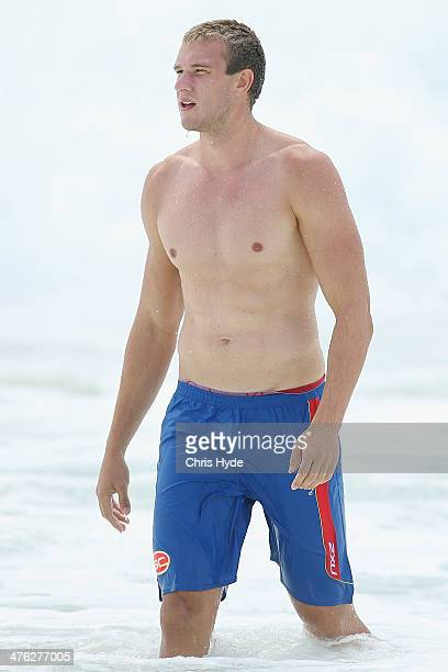 Sam Day of the Suns swims at Kurrawa Beach during a media session on March 3 2014 in Gold Coast Australia