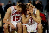 Sam Dekker and Ben Brust of the Wisconsin Badgers react after losing to the Kentucky Wildcats 7473 in the NCAA Men's Final Four Semifinal at ATT...