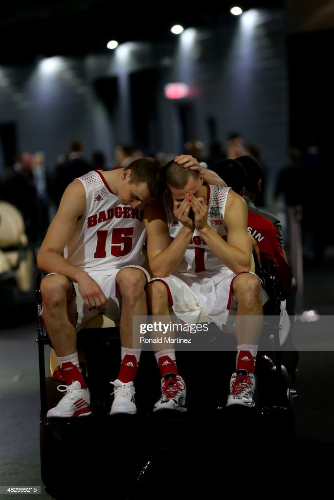 Sam Dekker #15 and Ben Brust #1 of the Wisconsin Badgers react after losing to the Kentucky Wildcats 74-73 in the NCAA Men's Final Four Semifinal at AT&T Stadium on April 5, 2014 in Arlington, Texas.