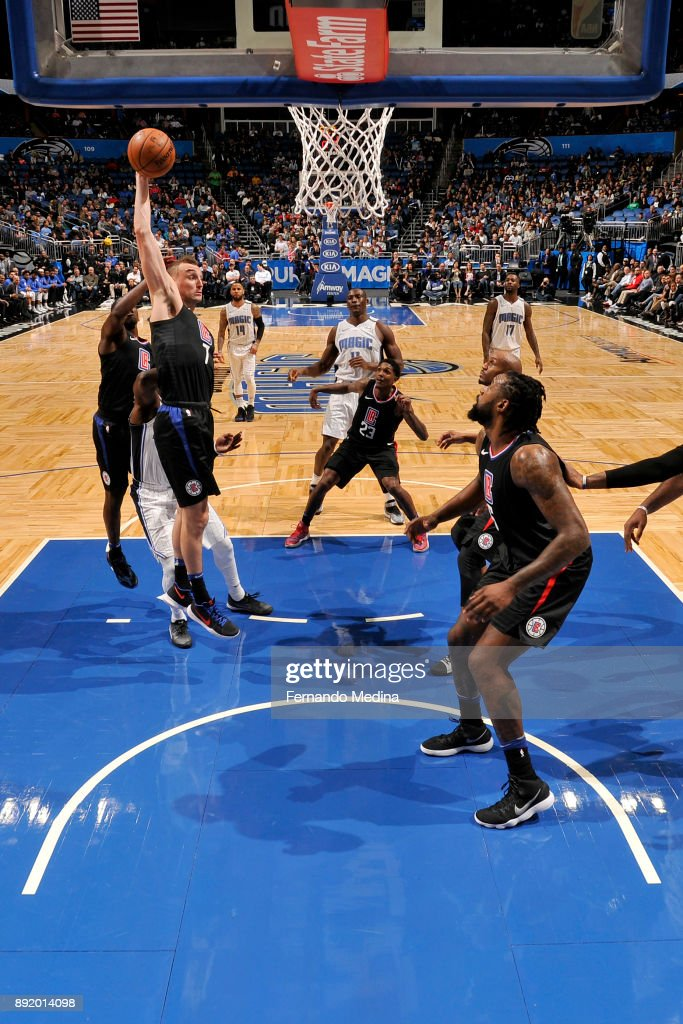 Sam Dekker #7 of the LA Clippers gets the rebound against the Orlando Magic during the game on December 13, 2017 at Amway Center in Orlando, Florida.