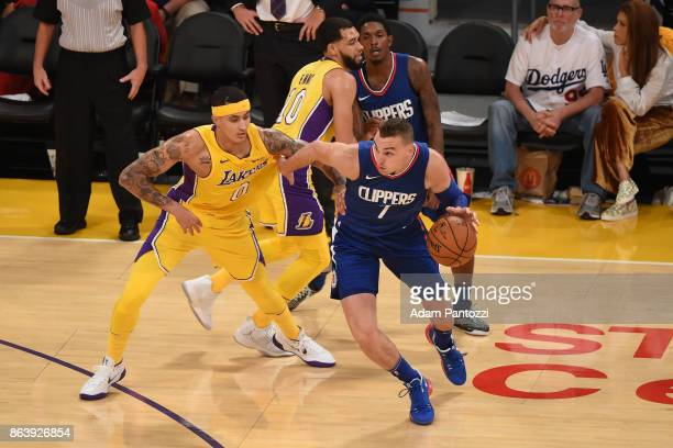 Sam Dekker of the LA Clippers handles the ball against Kyle Kuzma of the Los Angeles Lakers on October 19 2017 at STAPLES Center in Los Angeles...