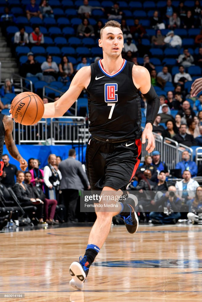 Sam Dekker #7 of the LA Clippers handles the ball against the Orlando Magic on December 13, 2017 at Amway Center in Orlando, Florida.