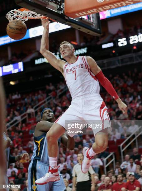 Sam Dekker of the Houston Rockets dunks against the Memphis Grizzlies during the second quarter at Toyota Center on March 4 2017 in Houston Texas...