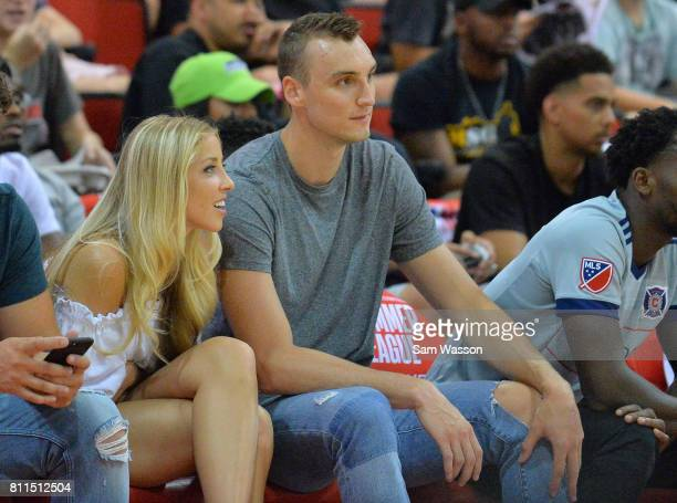 Sam Dekker of the Los Angeles Clippers and fiancee Olivia Harlan daughter of broadcaster Kevin Harlan watch a game between the Los Angeles Clippers...