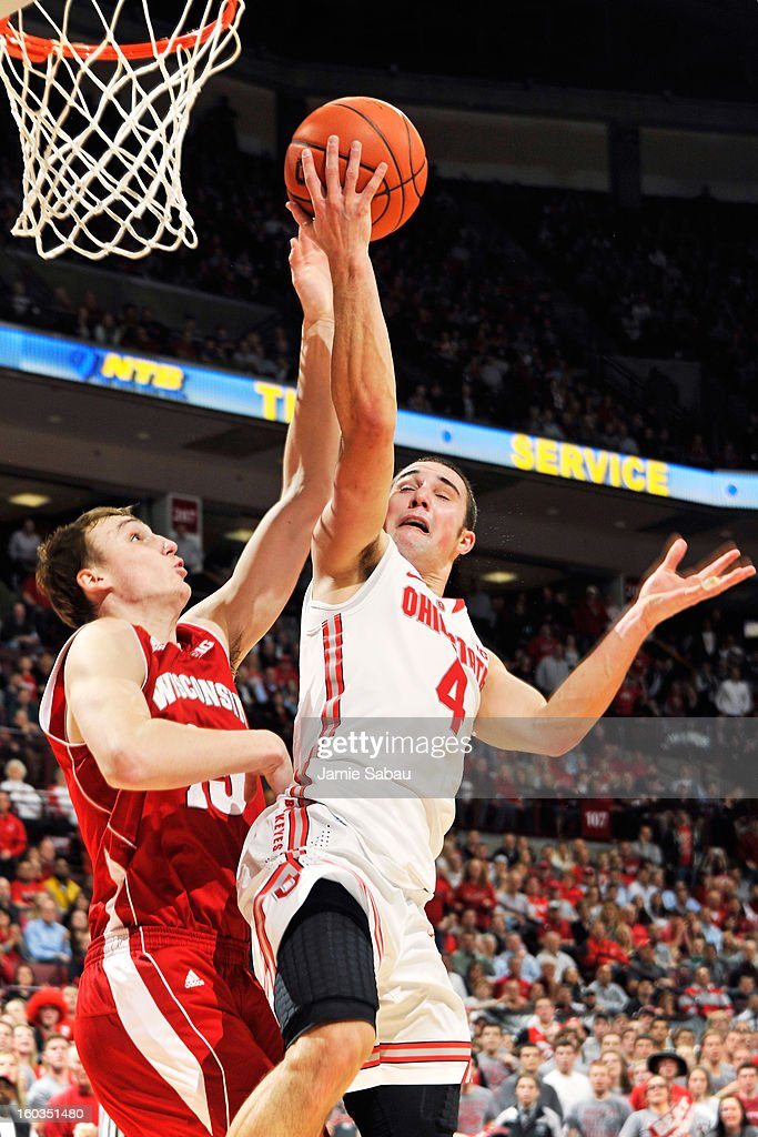 Sam Dekker #15 of the Wisconsin Badgers blocks a layup attempt by <a gi-track='captionPersonalityLinkClicked' href=/galleries/search?phrase=Aaron+Craft&family=editorial&specificpeople=7348782 ng-click='$event.stopPropagation()'>Aaron Craft</a> #4 of the Ohio State Buckeyes in the second half on January 29, 2013 at Value City Arena in Columbus, Ohio. Ohio State defeated Wisconsin 58-49.