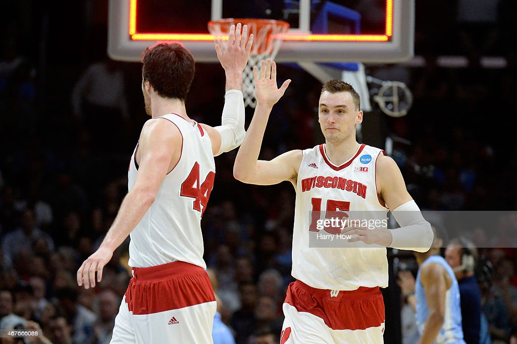 Sam Dekker of the Wisconsin Badgers celebrates with Frank Kaminsky after Dekker scores at the end of the first half against the North Carolina Tar...