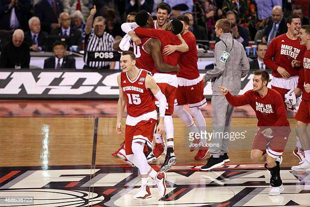 Sam Dekker of the Wisconsin Badgers celebrates with teammates after defeating the Kentucky Wildcats during the NCAA Men's Final Four Semifinal at...