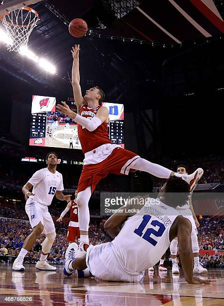 Sam Dekker of the Wisconsin Badgers drives to the basket against Justise Winslow of the Duke Blue Devils in the second half during the NCAA Men's...