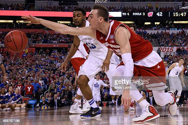 Sam Dekker of the Wisconsin Badgers goes for a loose ball against Matt Jones of the Duke Blue Devils in the second half during the NCAA Men's Final...