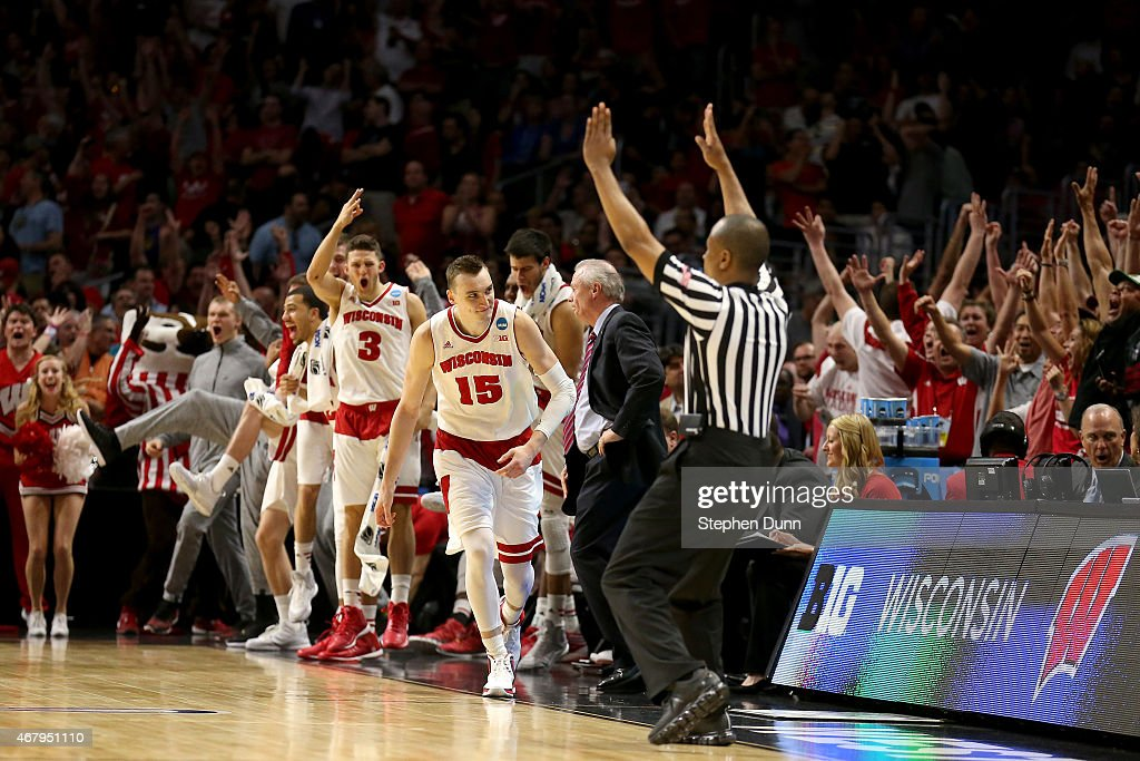 <a gi-track='captionPersonalityLinkClicked' href=/galleries/search?phrase=Sam+Dekker&family=editorial&specificpeople=7887140 ng-click='$event.stopPropagation()'>Sam Dekker</a> #15 of the Wisconsin Badgers reacts after making a three-pointer in the second half while taking on the Arizona Wildcats during the West Regional Final of the 2015 NCAA Men's Basketball Tournament at Staples Center on March 28, 2015 in Los Angeles, California.